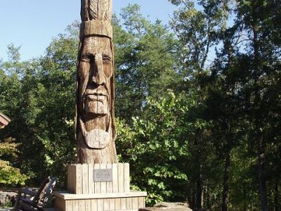 Visit the Peter Toth Trail of Tears Totem Pole inside Beavers Bend State Park.